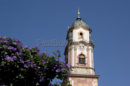 church tower with flowers