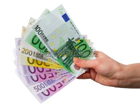reka z banknotami euro