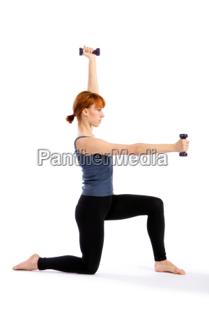fitness woman posing with dumbbells