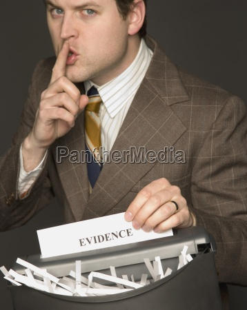 man shredding a document