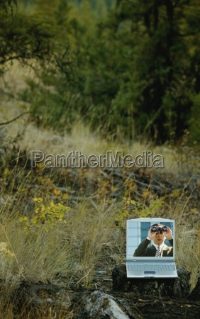 man with binoculars in field