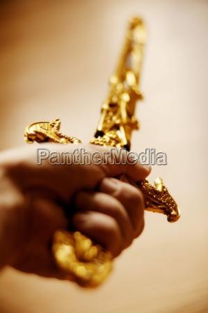 ornamental sword held aloft