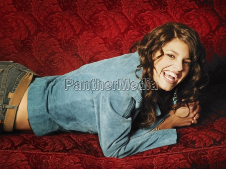 attractive woman laying on sofa and