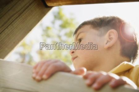 boy climbing side profile