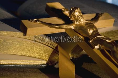 crucifix laying on open bible