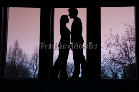silhouette of couple standing face to