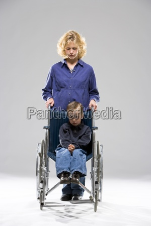 mother with child in wheelchair
