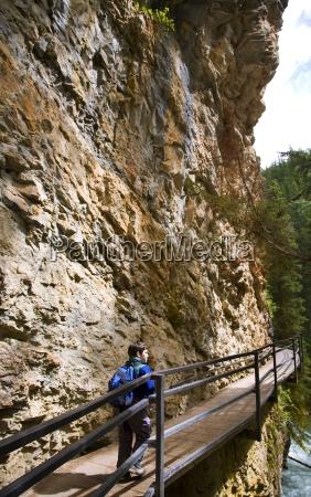 boy walking along johnson canyon banff