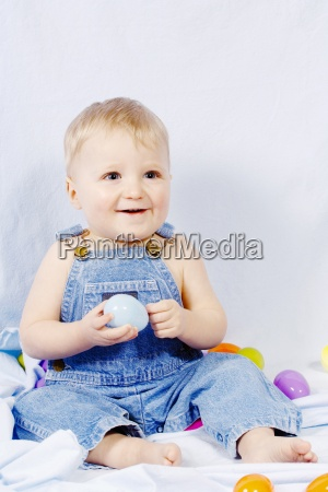 boy with easter eggs