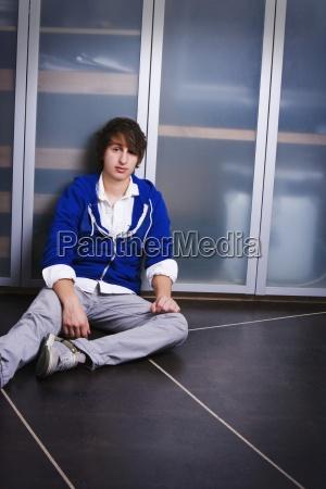 portrait of a teenage boy sitting