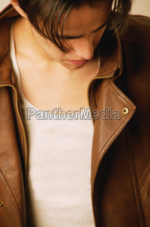 young man in brown leather jacket