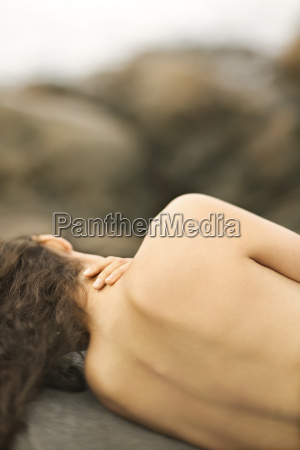 nude woman on rock