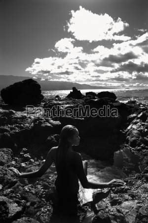 nude woman in tidal pool