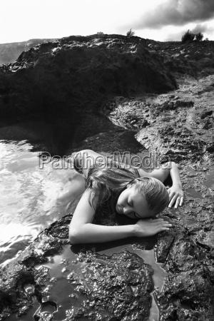 nude woman on rock