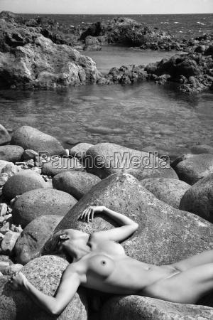nude woman on rocks