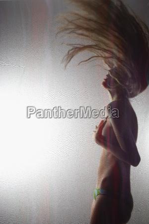 woman flinging hair