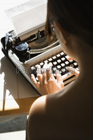 nude woman typing