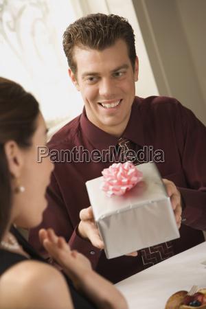 man giving woman gift