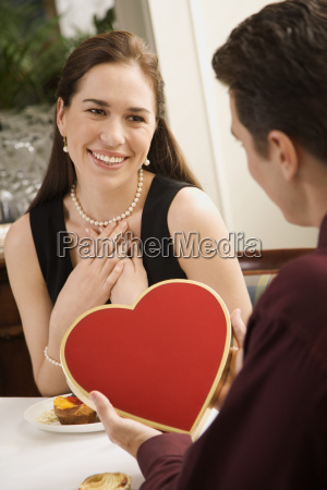 man giving woman valentine
