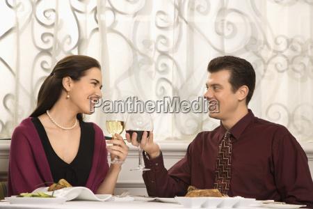 couple toasting glasses