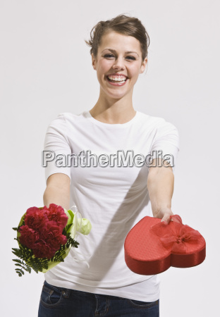 attractive, young, woman, holding, out, roses - 2824041