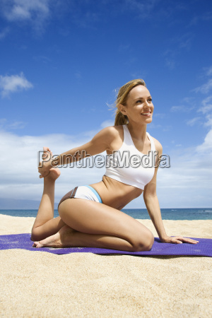 attractive young woman doing yoga on