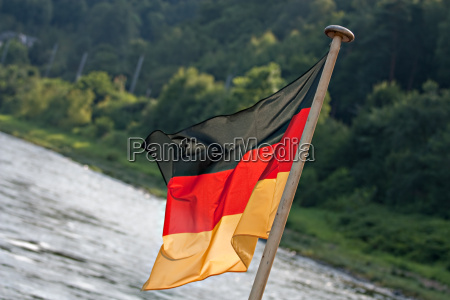 german flag flutters abyson at the
