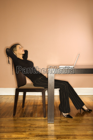 attractive young businesswoman looking up
