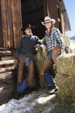 attractive couple in front of hay