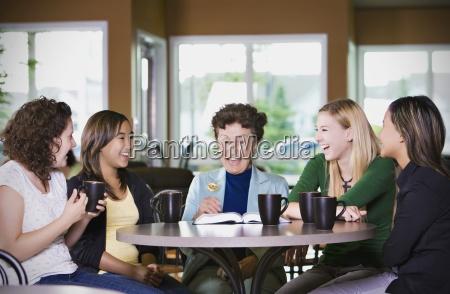 group of girls listening to senior
