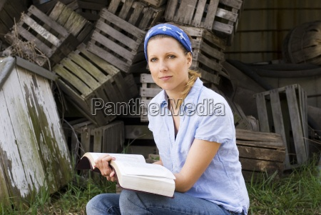 female missionary with open bible