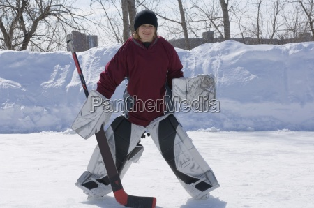 boy playing goalie in ice hockey