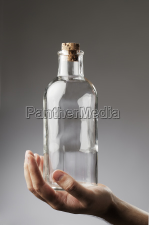 man holding an old fashioned glass