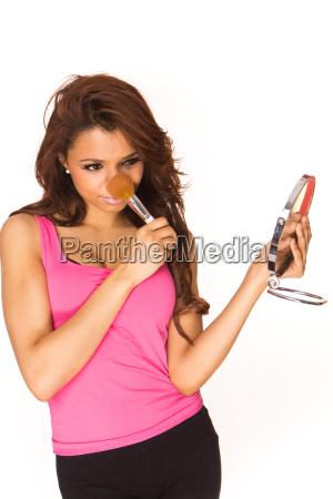 applying pink lipgloss