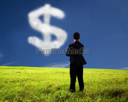 biznesmen mysli i ogladac znak pieniedzy