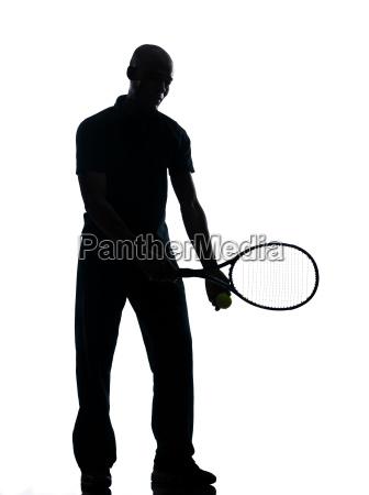 man tennis player at service