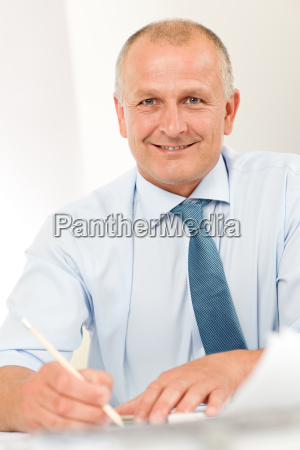 professional architect businessman behind table