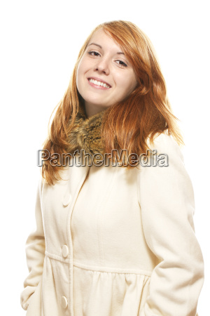 a young red haired smiling woman