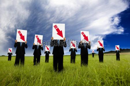 grupa biznesmen w czarny garnitur i