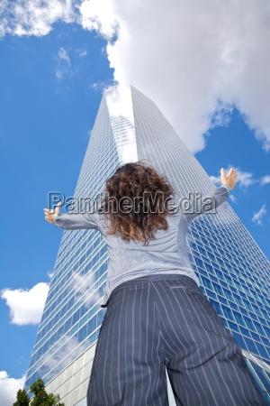 back businesswoman adoring crystal skyscraper