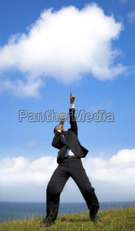 businessman holding megaphone with pointing