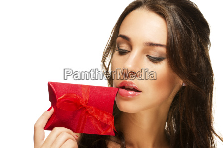 beautiful woman holding red gift close
