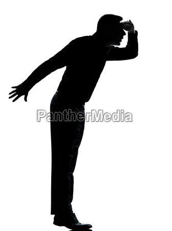 one business man silhouette tiptoe looking