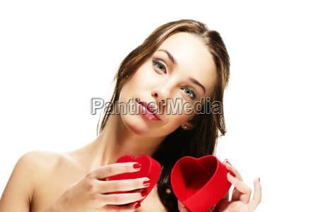 beautiful woman opens heart shaped box