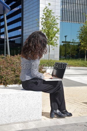 businesswoman working in the street