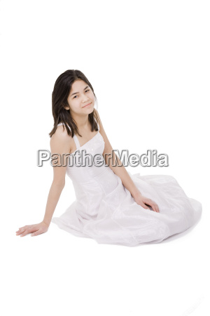 young teenage girl in white dress