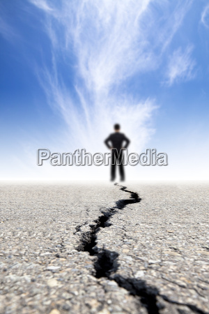 businessman stand on the crack road