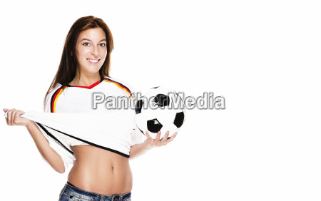 beautiful young woman presents football and