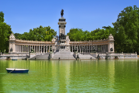 retiro park lake in madrid with