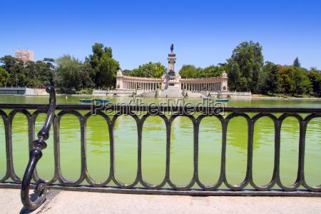 retiro park lake in madrid with